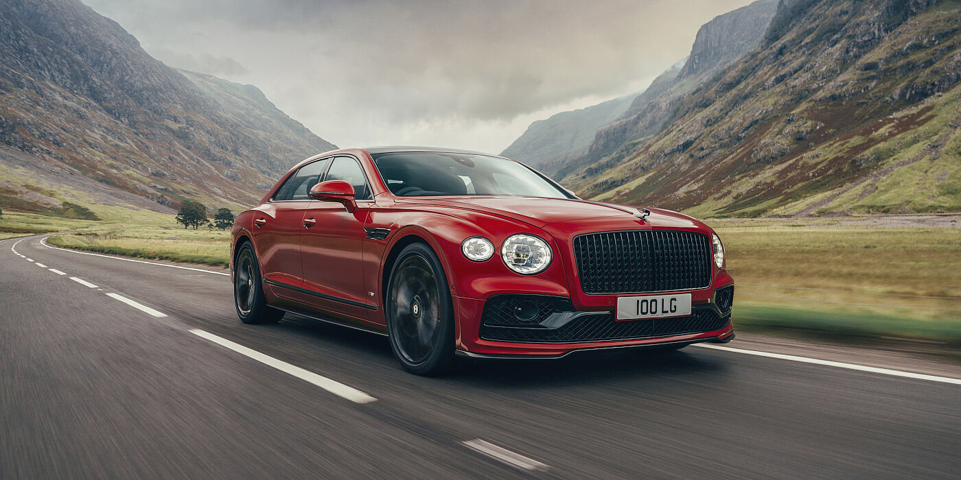 new-Bentley-Flying-Spur-V8-in-Dragon-Red-2-paint-colour-front-three-quarters-and-Blackline-specification-Glen-Coe-Scotland