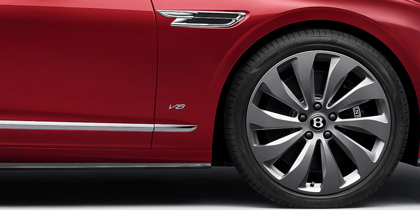 new-Bentley-Flying-Spur-V8-in-Dragon-Red-2-paint-colour-with-chrome-wheel-and-V8-badge